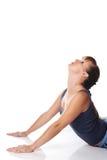 Kaukasisches Mädchen, welches die Yogahaltungen getrennt auf Weiß tut Lizenzfreie Stockfotografie
