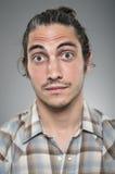 Kaukasisches Mann-weit gemustertes Überraschungs-Porträt Stockfotos