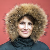 Kaukaska kobieta w futerkowym kapiszonie Obrazy Royalty Free