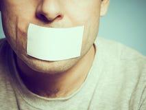 Kaukaski mężczyzna z kanał taśmą na usta, białym Obrazy Royalty Free