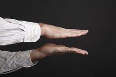Kaukaski męski ręki ściśnięcie coś Zdjęcia Royalty Free
