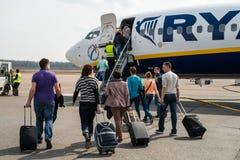 Kaunas airport. Flight boarding. Group of people goes to Ryanair airplane in Kaunas airport royalty free stock photos
