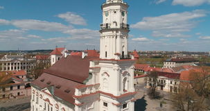 KAUNAS, LITHUANIA - APRIL 20, 2017: AERIAL. Slow lookdown drone shot of Town Hall in Town Hall square unveiling Kaunas castle, Kau. Nas, Lithuania on April 20 stock video