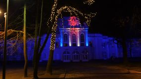 Kaunas, Lithuania - December 11th, 2017: Kaunas State Musical Theatre illuminated in various colors at night. 4k. Kaunas, Lithuania - December 11th, 2017: Kaunas stock footage