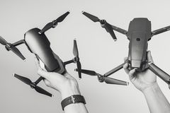 Holding DJI Mavic Air and Mavic Pro drones. KAUNAS, LITHUANIA - MARCH 03, 2018: Holding DJI Mavic Air and Mavic Pro drones stock photo