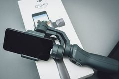 DJI Osmo Mobile 2. KAUNAS, LITHUANIA - MARCH 30, 2018: Unboxing new DJI Osmo Mobile. The Osmo hardware and mobile app allows smooth video shooting royalty free stock images