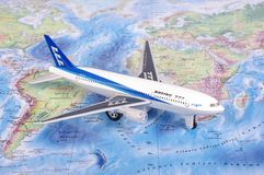 KAUNAS, LITHUANIA - NOVEMBER 05, 2017: Boeing 777 model on the w. Orld map. Travel concept Royalty Free Stock Photography