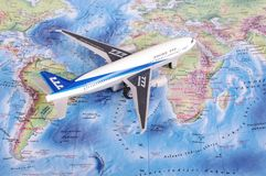 KAUNAS, LITHUANIA - NOVEMBER 05, 2017: Boeing 777 model on the w. Orld map. Travel concept Stock Photography