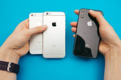Holding in hands a new Apple iPphone X, iPhone SE and iPhone 6S. KAUNAS, LITHUANIA - NOVEMBER 05, 2017: Holding in hands a new Apple iPhone X, iPhone SE and stock photo