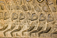 Kaurava Army bas relief, Angkor Wat. Bas relief carving of Kaurava foot soldiers heading at the Battle of Kurukshetra as described in the Mahabharata.  Western Royalty Free Stock Photo