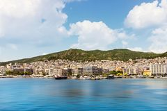 Kavala, Greece, view from the see and white clouds above background mountains royalty free stock images