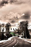 Kavarskas Saint John church, Lithuania. A road to the church in winter Stock Images