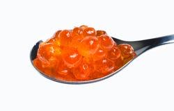 kaviar isolerad röd skedwhite Fotografering för Bildbyråer
