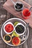 Kaviar und Blinis Stockfoto