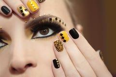 Kaviarmanikyr och makeup Arkivbilder