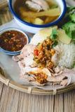 Kaw Man Kai, Delicious Hainanese chicken rice on wood background Royalty Free Stock Photography