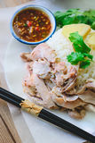 Kaw Man Kai, Delicious Hainanese chicken rice on wood background Royalty Free Stock Images