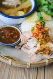 Kaw Man Kai, Delicious Hainanese chicken rice on wood background Royalty Free Stock Image