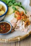 Kaw Man Kai, Delicious Hainanese chicken rice on wood background Royalty Free Stock Photo