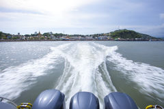 KAW THAUNG MYANMAR - MAY7 : rear view of speed boat departure fr Stock Photos