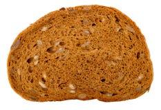 Kawał slawistyczny chleb z słonecznikowymi ziarnami na białym backgr fotografia royalty free