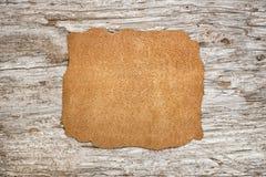 Kawałek skóra na starym drewnie fotografia royalty free