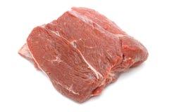 Kawałek surowa wołowina na bielu Zdjęcia Stock