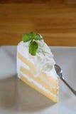 Kawałek kokosowy tort na drewnianym stole Zdjęcie Royalty Free