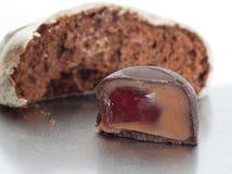 Kawałek tort i czekoladowy cukierek Obraz Stock