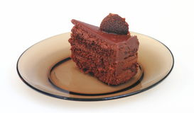 Kawałek tort na ciemnym naczyniu Zdjęcie Royalty Free