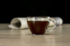 Kawa i gazeta na stole Zdjęcia Stock