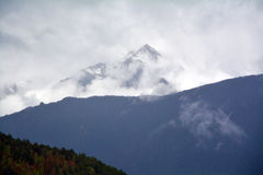 Kawa karpo snow mountains with cloud in sky. Shangri-la, China Stock Photos