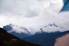 Kawa karpo snow mountains with tibet flags Stock Image