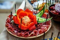 Kawałki salami na talerzu Obrazy Stock