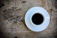 Kawa na Drewnianym stole Zdjęcia Stock