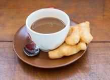 Kawa na Drewnianym stole Zdjęcie Stock