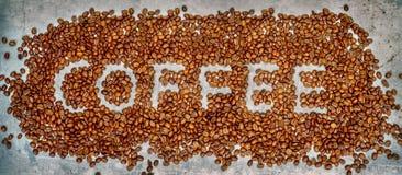 Kawa pisać w kawowych fasolach Zdjęcie Royalty Free