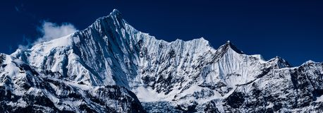Kawagarbo Snow Mountain. Kawagarbo is one of the most sacred mountains for Tibetan Buddhism as the spiritual home of a warrior god of the same name Royalty Free Stock Photo