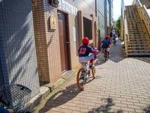 Kawagoe, Japan - May 14, 2017: Group children biking to school, in Kawagoe, Japan. Kawagoe, Japan - May 14, 2017: Group children biking to school, in Kawagoe royalty free stock images