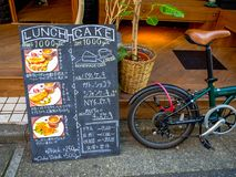 Kawagoe, Japan - May 14, 2017: Informative sign with a bike parket outside of the the testaurant, in Kawagoe, Japan Royalty Free Stock Images