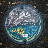 Manhole cover. Kawaguchi, Japan - November 1, 2018: Manhole cover on the street near lake Kawaguchi, Japan stock photography