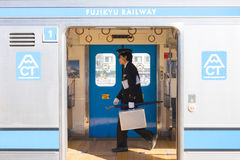 Kawaguchiko, Japan - February 20, 2016 : station master walking Stock Image