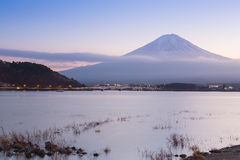 Kawaguchiko Lake with Fuji Mountain background during twilight Royalty Free Stock Image