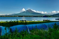 View to Mount Fuji with Boats in Summer with blue sky and clouds Stock Photos