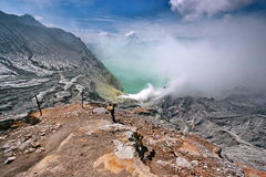 Kawah Ijen. This photo shows the condition of Kawah Ijen (Ijen Caldera)and a miner carries a load of sulfur inside the volcano at Kawah Ijen at Bondowowo, East royalty free stock image