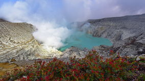 Kawah Ijen volcanic crater emitting sulphuric gas Stock Photos