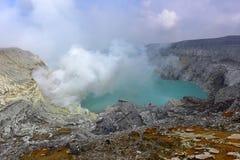 Kawah Ijen volcanic crater emitting sulphuric gas still used for sulphur mining in East Java Stock Photos