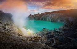 Kawah Ijen volcano with green lake on blue sky background at morning in East Java, Indonesia. royalty free stock images