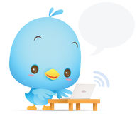 Kawaii Blue Bird using laptop Royalty Free Stock Photo