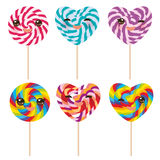 Kawaii Heart shaped candy lollipop with pink cheeks and winking eyes, colorful spiral candy cane. Candy on stick with twisted desi Royalty Free Stock Image